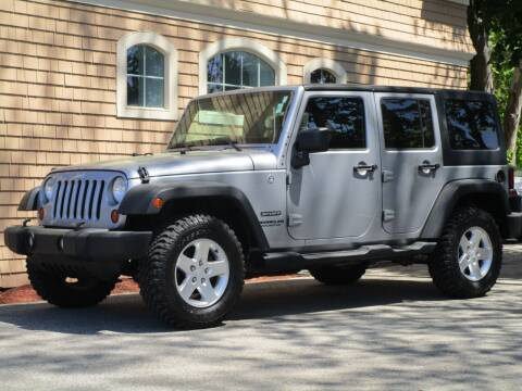 2013 Jeep Wrangler Unlimited for sale at Car and Truck Exchange, Inc. in Rowley MA