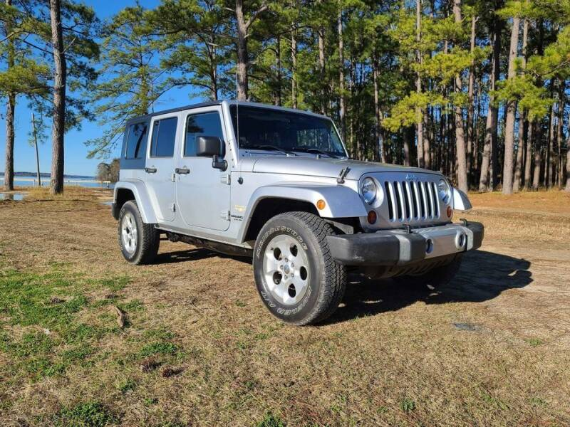 2009 Jeep Wrangler Unlimited for sale at RED ALLEN DIESEL in Anacoco LA