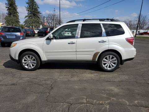 2011 Subaru Forester for sale at Drive Motor Sales in Ionia MI