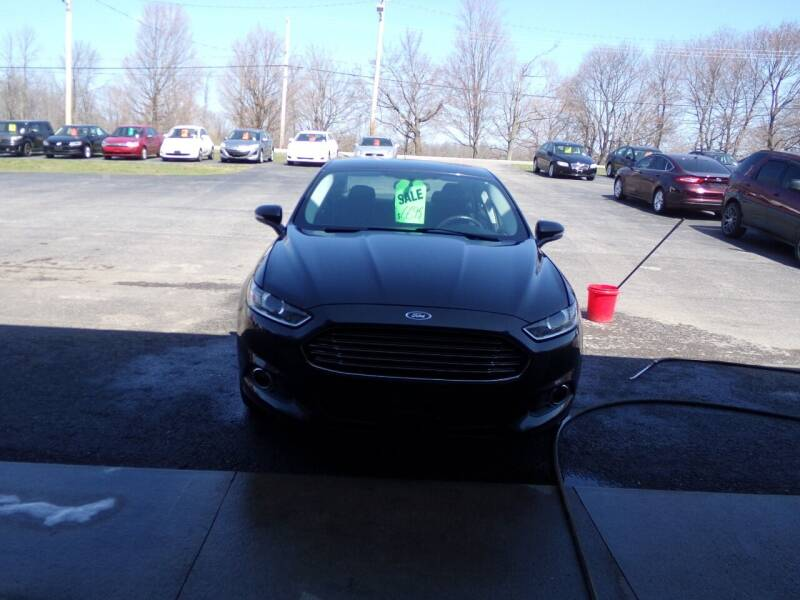 2013 Ford Fusion for sale at Pool Auto Sales Inc in Spencerport NY