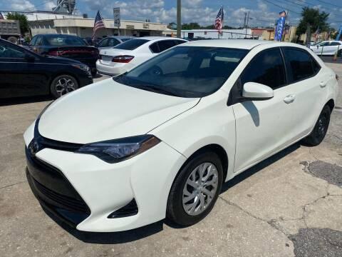 2018 Toyota Corolla for sale at P J Auto Trading Inc in Orlando FL