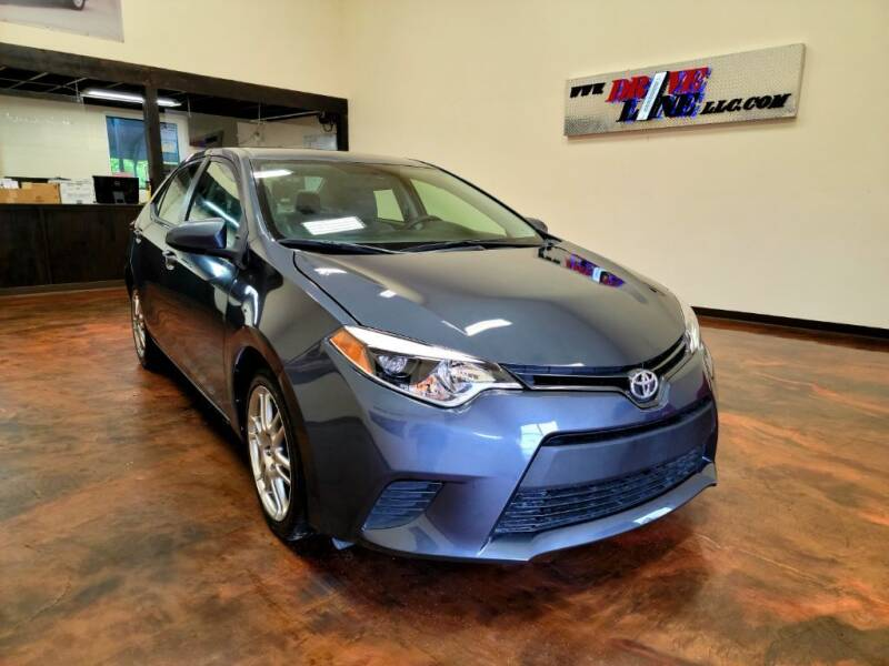 2015 Toyota Corolla for sale at Driveline LLC in Jacksonville FL