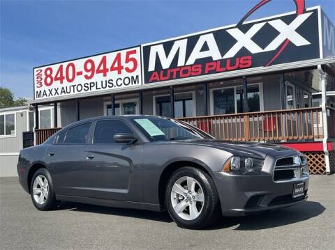 2013 Dodge Charger for sale at Maxx Autos Plus in Puyallup WA