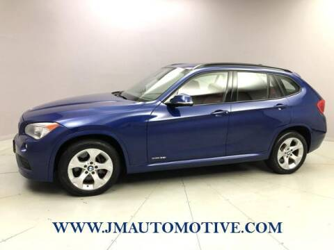 2013 BMW X1 for sale at J & M Automotive in Naugatuck CT