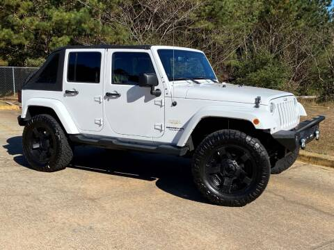2014 Jeep Wrangler Unlimited for sale at Selective Cars & Trucks in Woodstock GA