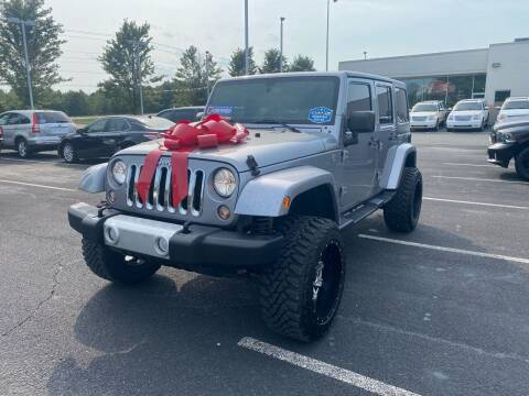 2015 Jeep Wrangler Unlimited for sale at Charlotte Auto Group, Inc in Monroe NC