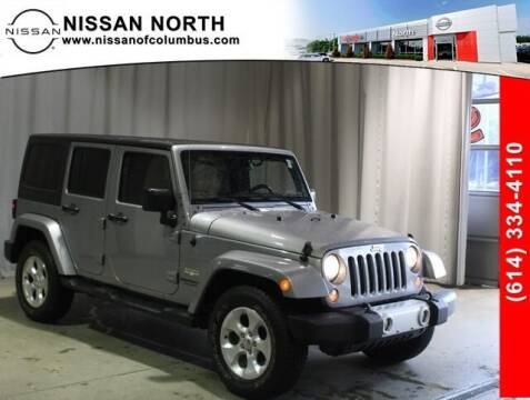 2015 Jeep Wrangler Unlimited for sale at Auto Center of Columbus in Columbus OH