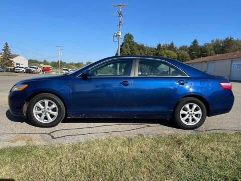 2009 Toyota Camry for sale at J & K AUTO SALES LLC in Holland MI