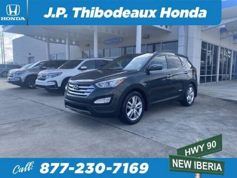 2014 Hyundai Santa Fe Sport for sale at J P Thibodeaux Used Cars in New Iberia LA