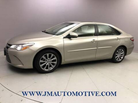 2015 Toyota Camry for sale at J & M Automotive in Naugatuck CT