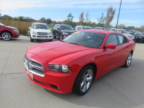 2013 Dodge Charger for sale at Azteca Auto Sales LLC in Des Moines IA