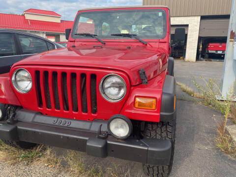 2002 Jeep Wrangler for sale at Story Brothers Auto in New Britain CT
