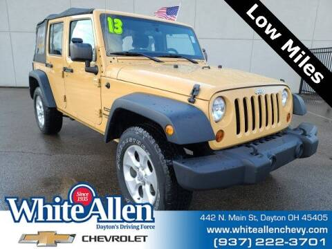 2013 Jeep Wrangler Unlimited for sale at WHITE-ALLEN CHEVROLET in Dayton OH