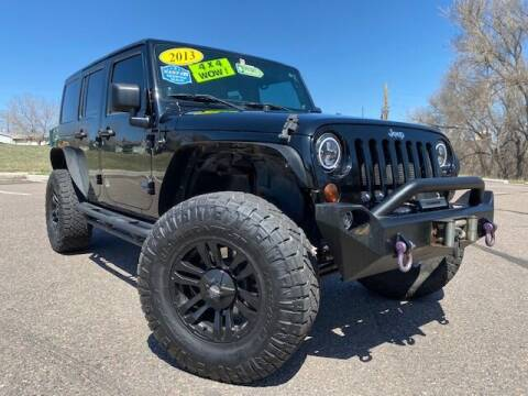 2013 Jeep Wrangler Unlimited for sale at UNITED Automotive in Denver CO