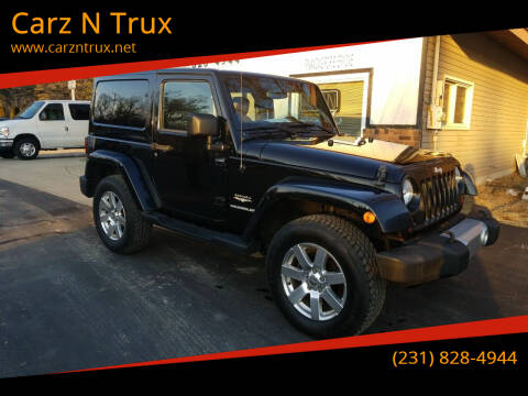 2013 Jeep Wrangler for sale at Carz N Trux in Twin Lake MI