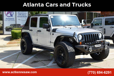 2010 Jeep Wrangler Unlimited for sale at Atlanta Cars and Trucks in Kennesaw GA