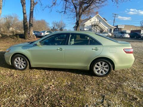 2009 Toyota Camry Hybrid for sale at Rodeo Auto Sales Inc in Winston Salem NC