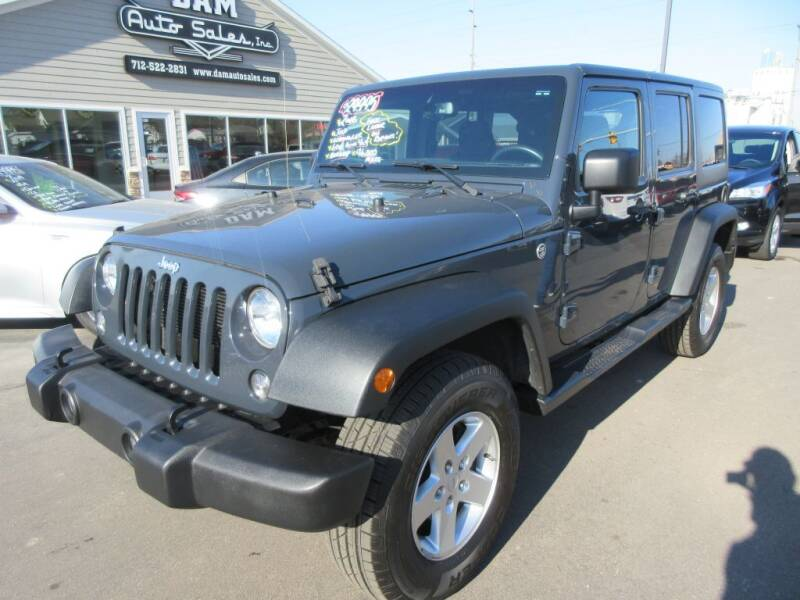 2016 Jeep Wrangler Unlimited for sale at Dam Auto Sales in Sioux City IA