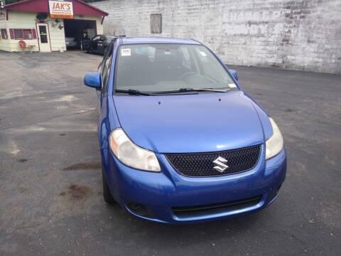 2012 Suzuki SX4 for sale at Jak's Preowned Autos in Saint Joseph MO