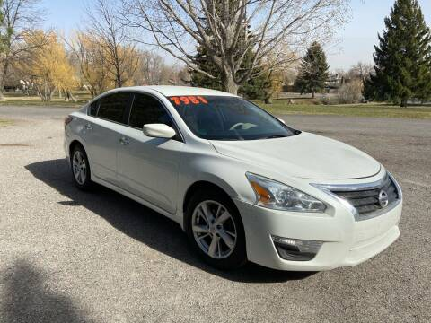 2014 Nissan Altima for sale at BELOW BOOK AUTO SALES in Idaho Falls ID