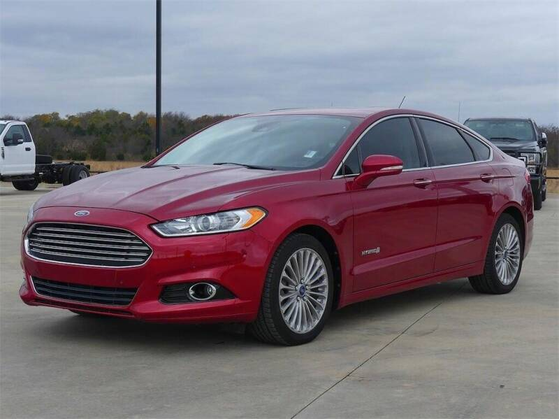 2013 Ford Fusion Hybrid for sale at KHAN'S AUTO LLC in Worland WY