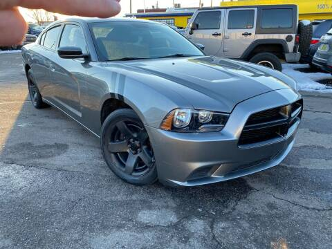2012 Dodge Charger for sale at New Wave Auto Brokers & Sales in Denver CO