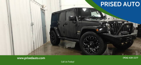 2015 Jeep Wrangler Unlimited for sale at PRISED AUTO in Gladstone MI