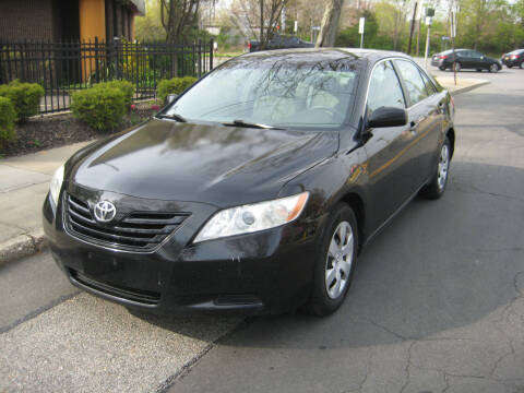 2009 Toyota Camry for sale at Top Choice Auto Inc in Massapequa Park NY