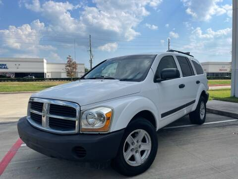 2006 Dodge Durango for sale at TWIN CITY MOTORS in Houston TX