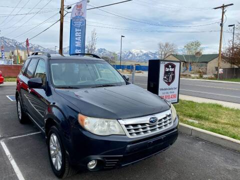 2012 Subaru Forester for sale at The Car-Mart in Murray UT