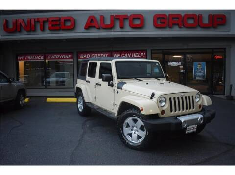 2011 Jeep Wrangler Unlimited for sale at United Auto Group in Putnam CT