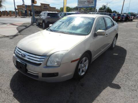 2009 Ford Fusion for sale at AUGE'S SALES AND SERVICE in Belen NM