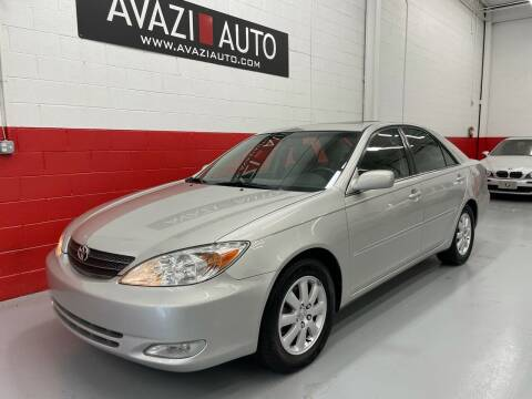 2003 Toyota Camry for sale at AVAZI AUTO GROUP LLC in Gaithersburg MD