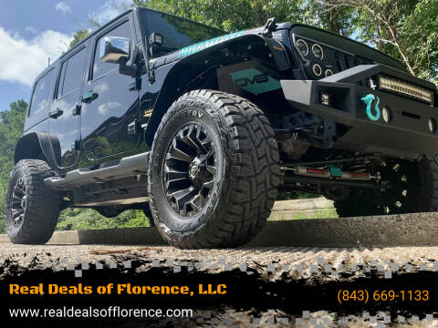 2014 Jeep Wrangler Unlimited for sale at Real Deals of Florence, LLC in Effingham SC