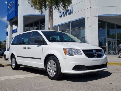 2014 Dodge Grand Caravan for sale at DORAL HYUNDAI in Doral FL