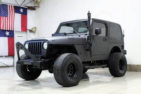 2004 Jeep Wrangler for sale at ROADSTERS AUTO in Houston TX