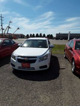 2011 Chevrolet Cruze for sale at BARNES AUTO SALES in Mandan ND