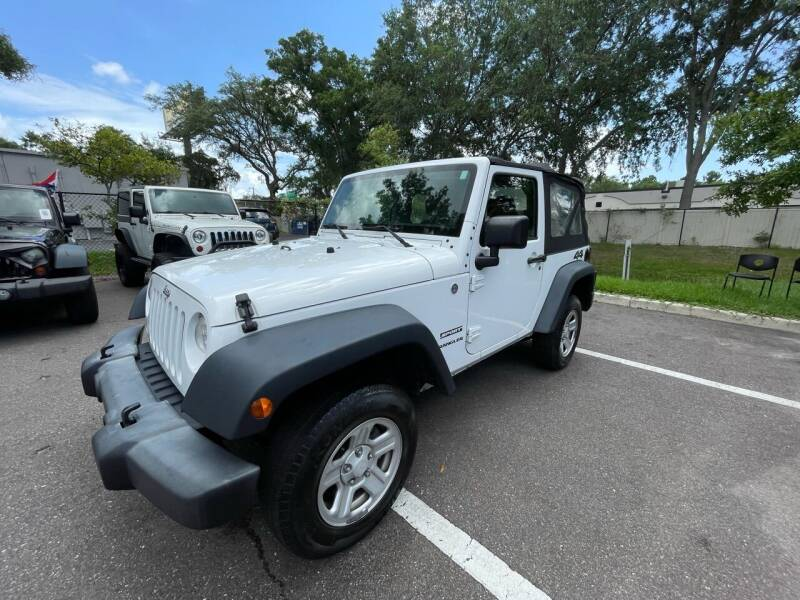 2014 Jeep Wrangler for sale at Bay City Autosales in Tampa FL