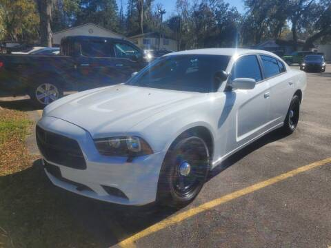 2014 Dodge Charger for sale at REDLINE MOTORGROUP INC in Jacksonville FL