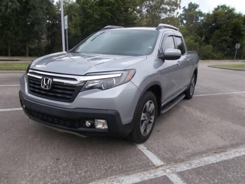 2017 Honda Ridgeline for sale at ACH AutoHaus in Dallas TX