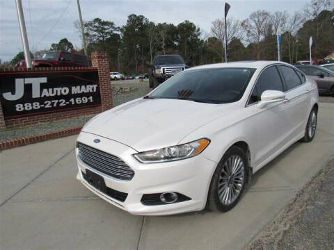 2014 Ford Fusion for sale at J T Auto Group in Sanford NC