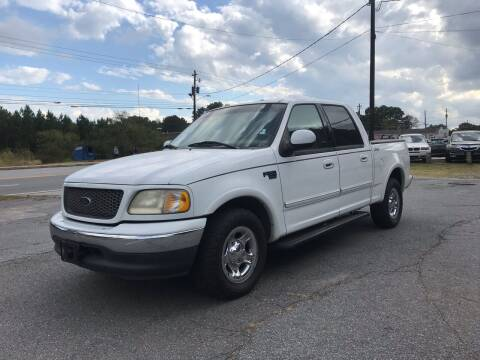 2001 Ford F-150 for sale at CAR STOP INC in Duluth GA