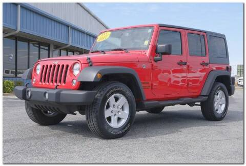 2017 Jeep Wrangler Unlimited for sale at STRICKLAND AUTO GROUP INC in Ahoskie NC