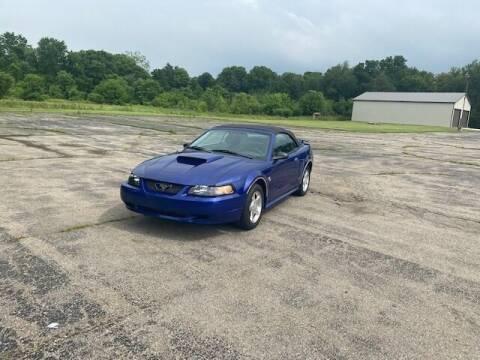 2004 Ford Mustang for sale at Caruzin Motors in Flint MI