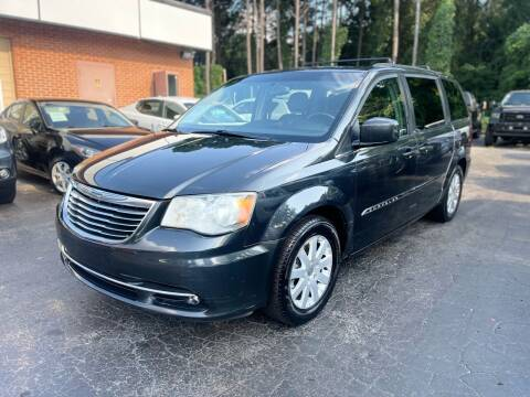 2012 Chrysler Town and Country for sale at Magic Motors Inc. in Snellville GA