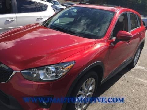 2015 Mazda CX-5 for sale at J & M Automotive in Naugatuck CT