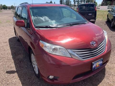 2012 Toyota Sienna for sale at Praylea's Auto Sales in Peyton CO
