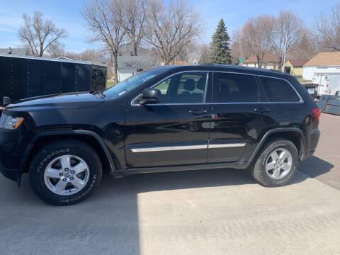 2011 Jeep Grand Cherokee for sale at Los Arreglados Auto Sales in Worthington MN