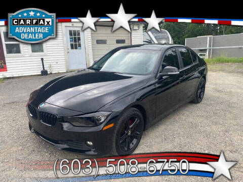 2014 BMW 3 Series for sale at J & E AUTOMALL in Pelham NH