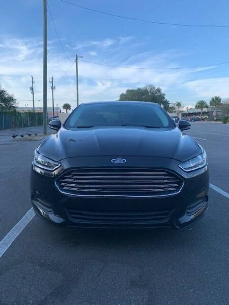 2014 Ford Fusion Hybrid for sale at Royal Auto Mart in Tampa FL